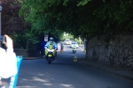 Police motorbike escorts Olympic Torch